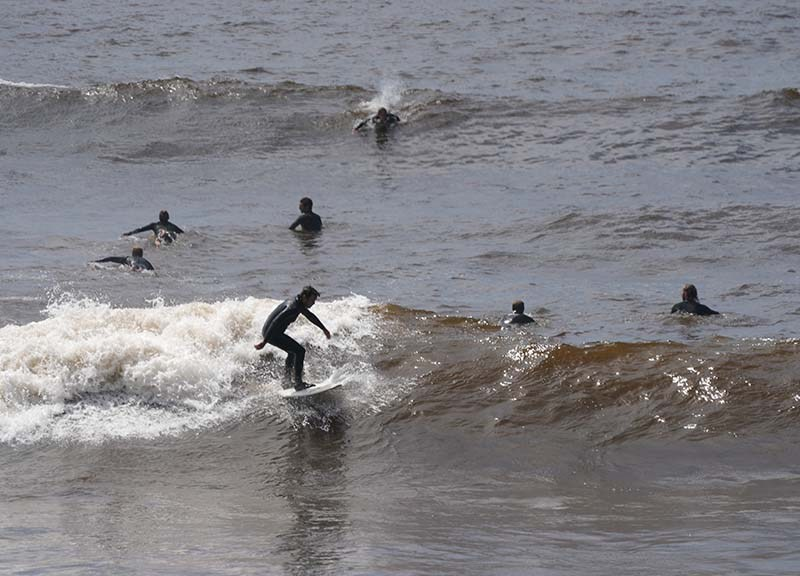 Surfers flocked to the waves Monday afternoon at Windansea in La Jolla.