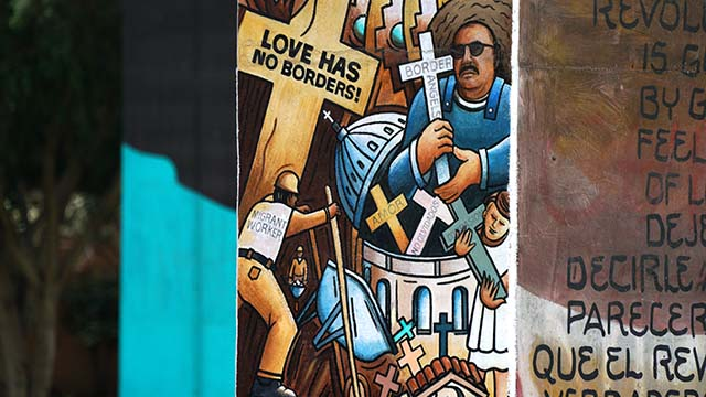 An image of Enrique Morones is part of a mural on a support structure in Chicano Park in Barrio Logan.