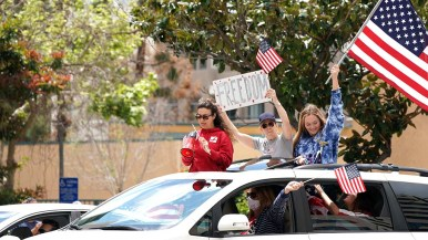 Many cars repeatedly circled downtown to display flags and signs at the intersection of State Street and Broadway.