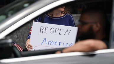 """The simple sentiment """"Reopen America"""" was the unifying theme of downtown rally."""