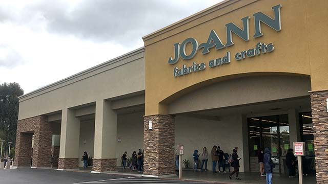 A long line of customers, wrapping around the side of the building, wait in line at Joann Fabrics and Crafts in Fletcher Hills after the CDC recommended people make cloth masks during the coronavirus pandemic.