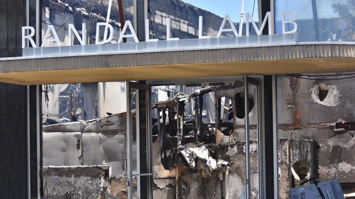 Randall Lamb, a consulting firm, was destroyed by protesters. It is a historical building in La Mesa.
