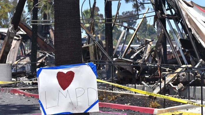 Pro-police posters stationed in front of Union Bank were burned to the ground by protesters in downtown La Mesa.