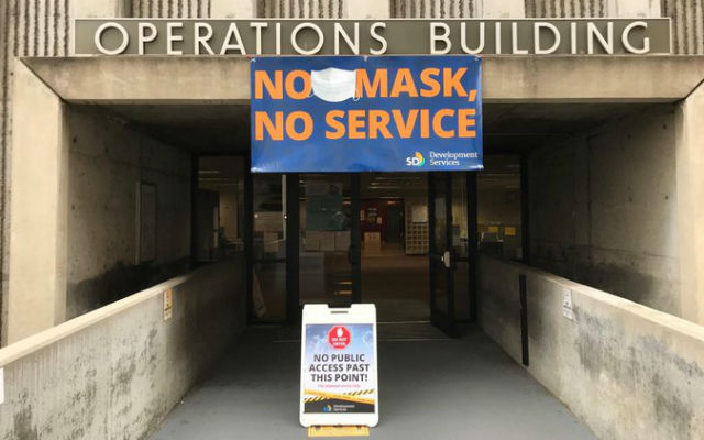 """No mask, no service"" sign"