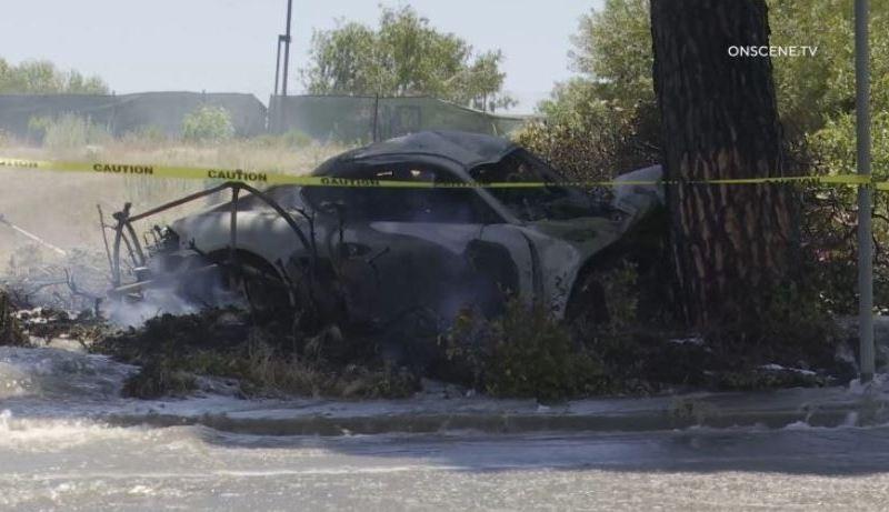 smoking wreckage of car