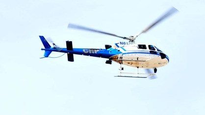 A CHP helicopter monitored the scene from above the La Mesa police station.