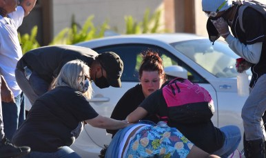 A woman is treated for a medical problem after tears gas was released at La Mesa police station.