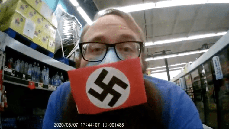 """A screen shot of Dustin Hart video of himself at Santee Food 4 Less includes a BitChute ID of """"1488,"""" references to Hitler or neo-Nazi views."""