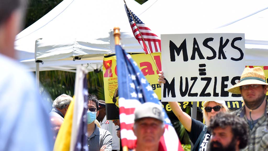The vast majority of rally-goers didn't wear a face mask. One equated masks to muzzles.