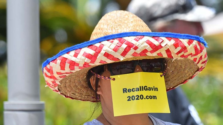 A website-promoting card served double duty as a face mask at the harborfront rally.
