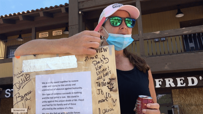 Richard Delaney from Jamul brought a sign to sign with a message of hope for La Mesans.