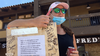 Richard Delaney of Jamul brought a board to sign with a message of hope for La Mesans.