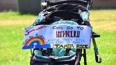 A protester put a sign on stroller for a Black Lives Matter protest at San Diego Mission Bay Park.