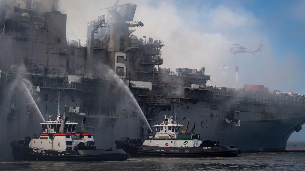 Fireboats and a helicopter battle the blaze