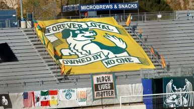 A large team flag rests on the bleacher section where the Locals usually cheer.