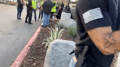 Counterprotester at July 25 event wore two hunting knives on his belt