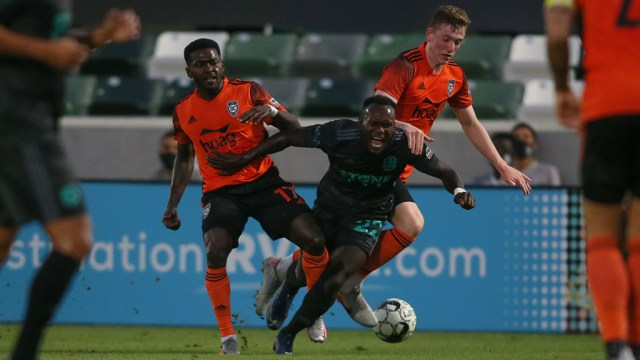 The San Diego Loyal played strong defense against Orange County SC as Francis Atuahene tangles (center) tangles with opponents.