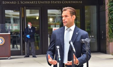 Assistant U.S. Attorney Mark Conover speaks to reporters after the sentencing of Margaret Hunter, wife of former Congressman Duncan D. Hunter, on corruption charges.