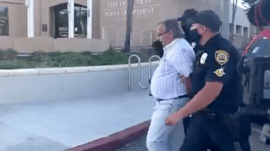 Roger Ogden is led to the La Mesa police station, where he says he was detained for 45 minutes before release with no charges.