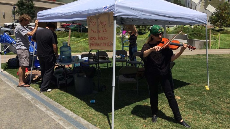 Nina Leilani Deering, late co-founder of Voices of Our City choir, plays violin in July 2016 at Faultline Park in East Village.