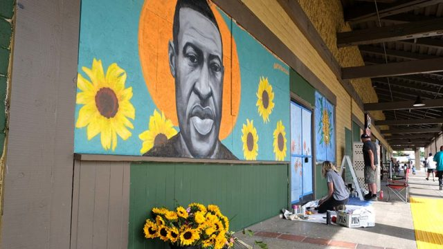 Artist Chloe Becky painted the image of George Floyd, the man killed in police custody in Minneapolis , near a La Mesa beauty school.