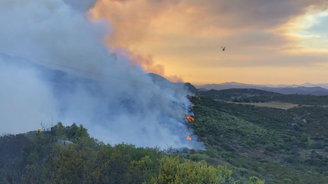 Valley Fire moves along a hill