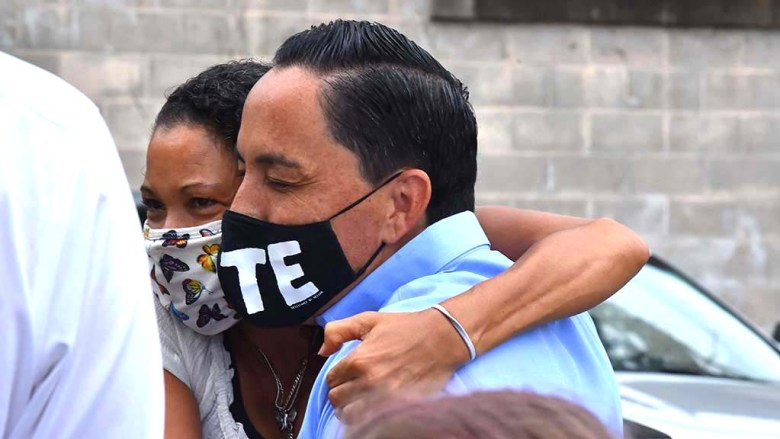 Supporter Elene Bratton of San Diego hugs Assemblyman Todd Gloria at a early morning start of canvassing for his mayoral campaign.
