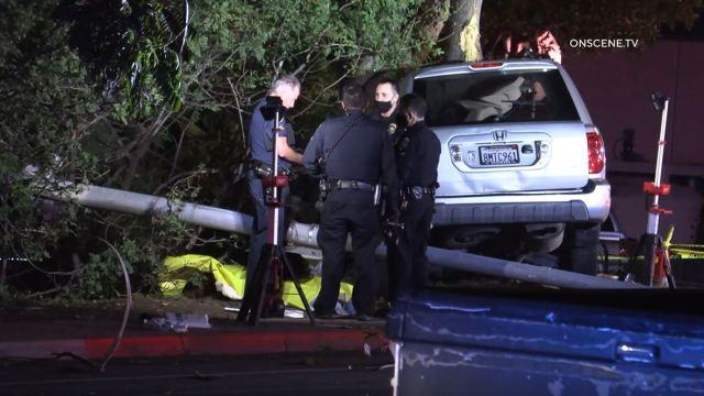 Police examine wrecked SUV