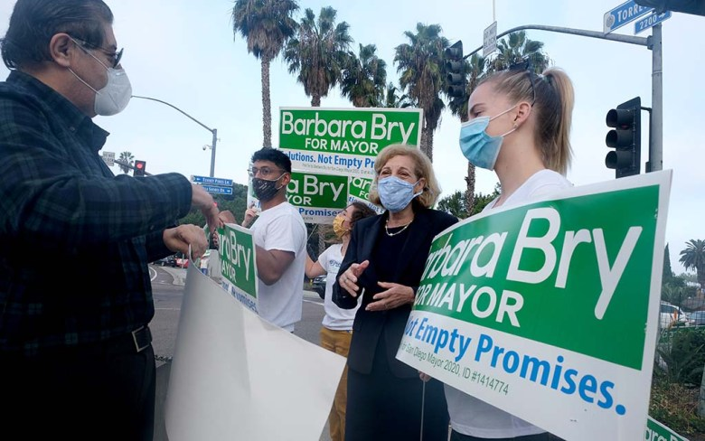 Mayoral candidate Barbara Bry speaks with supporters including Richard Ybarra (left) on election day in La Jolla.