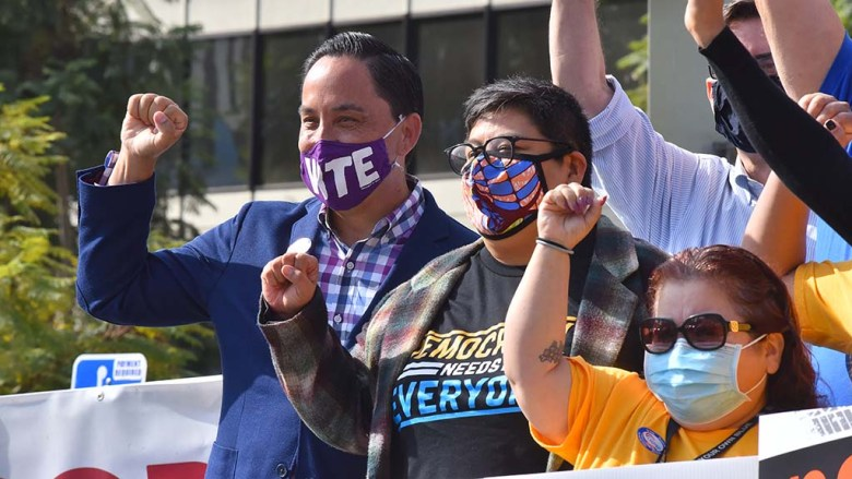 Mayoral candidate Todd Gloria (left) and congressional candidate Georgette Gomez (center) show their support of labor unions on an Election Day car rally downtown.