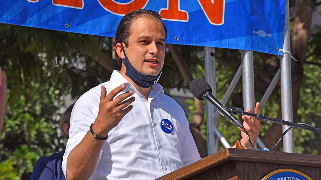 City Council candidate Raul Campillo speaks to union workers at a car rally downtown on Election Day.