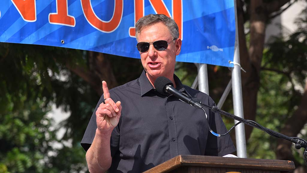 U.S. Rep. Scott Peters speaks to union workers at a car rally downtown on Election Day.