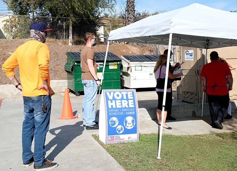 Voters line up at a poll in Santee