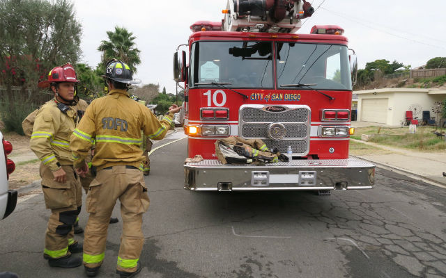 Firefighters outside home