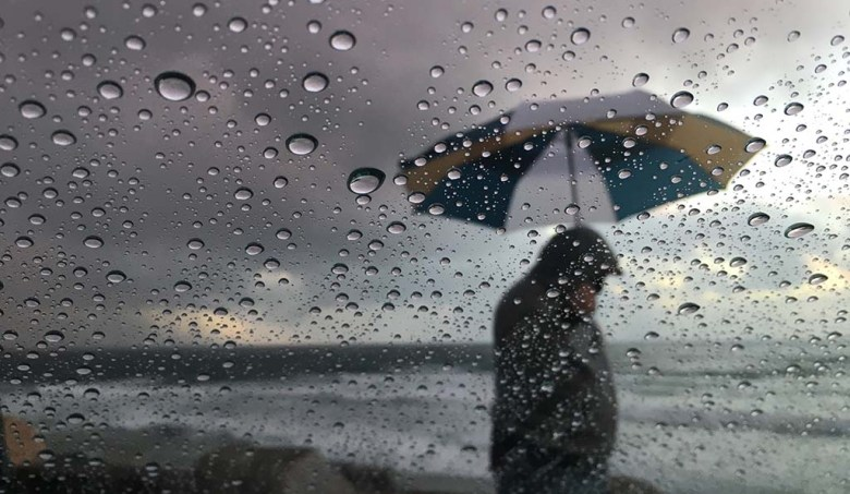 Rain fell intermittently on the coast Monday as rain cells moved through the county.
