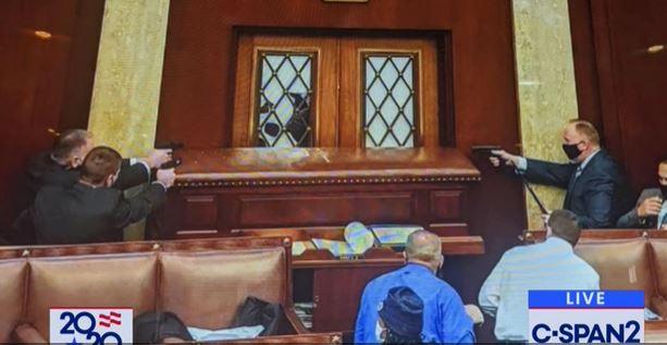 Capitol Police draw guns