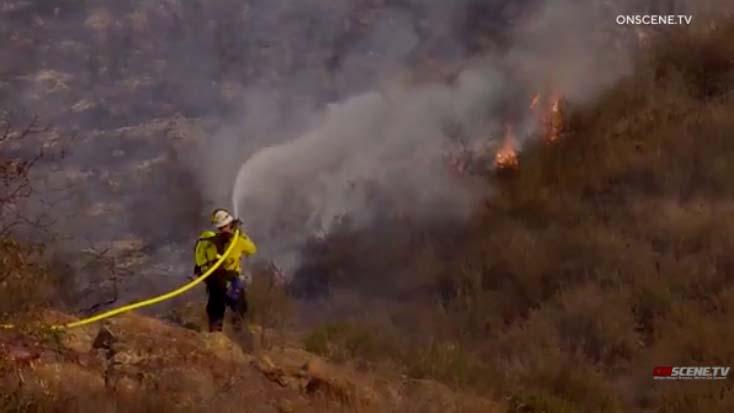 Firefighter trains water on Chula Vista blaze.