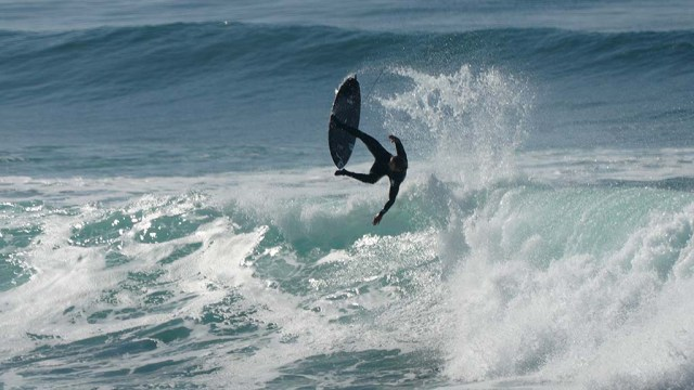 A surfer wipes out as up to 10-foot waves were the result of a west-northwest swell along the West Coast.