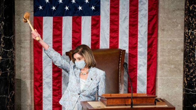 Speaker of the House Nancy Pelosi holds the gavel in the air