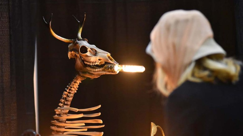 A deer skeleton with a light bulb in its mouth was among the oddities at the Oddities & Curiosities Expo at the Del Mar Fairgrounds.