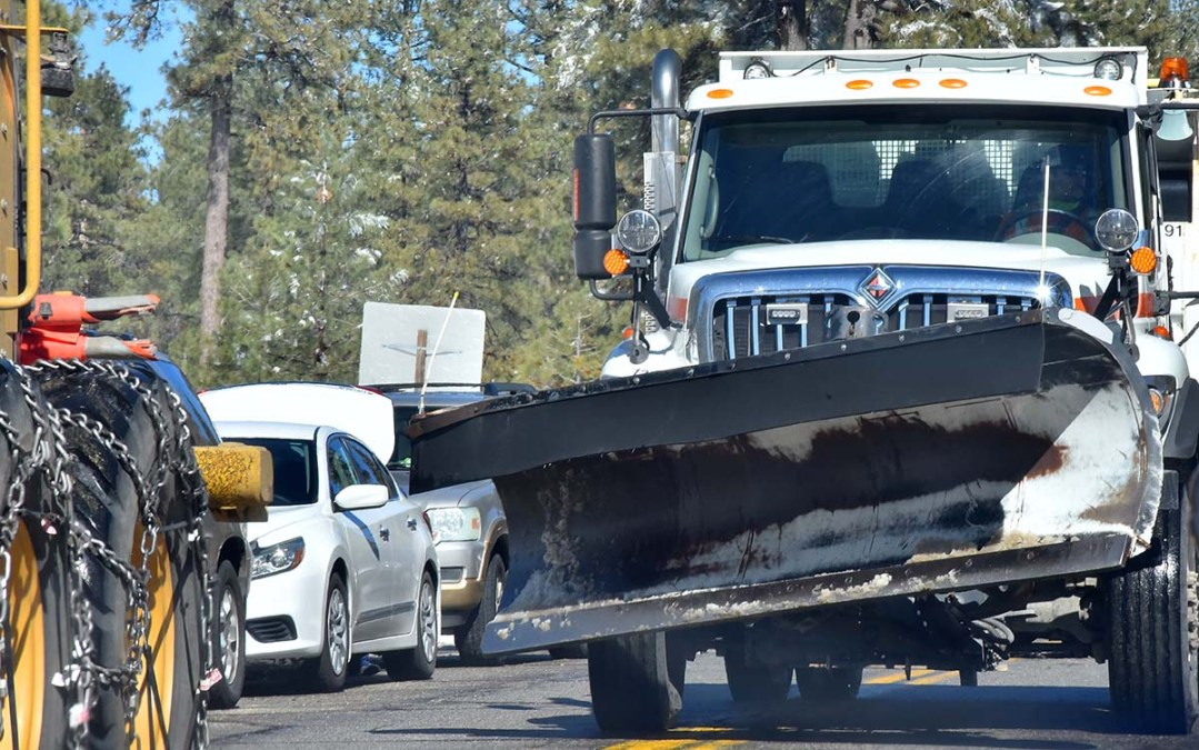 Snow plows were still busy two days after inches fell in the mountains on the weekend and Monday.