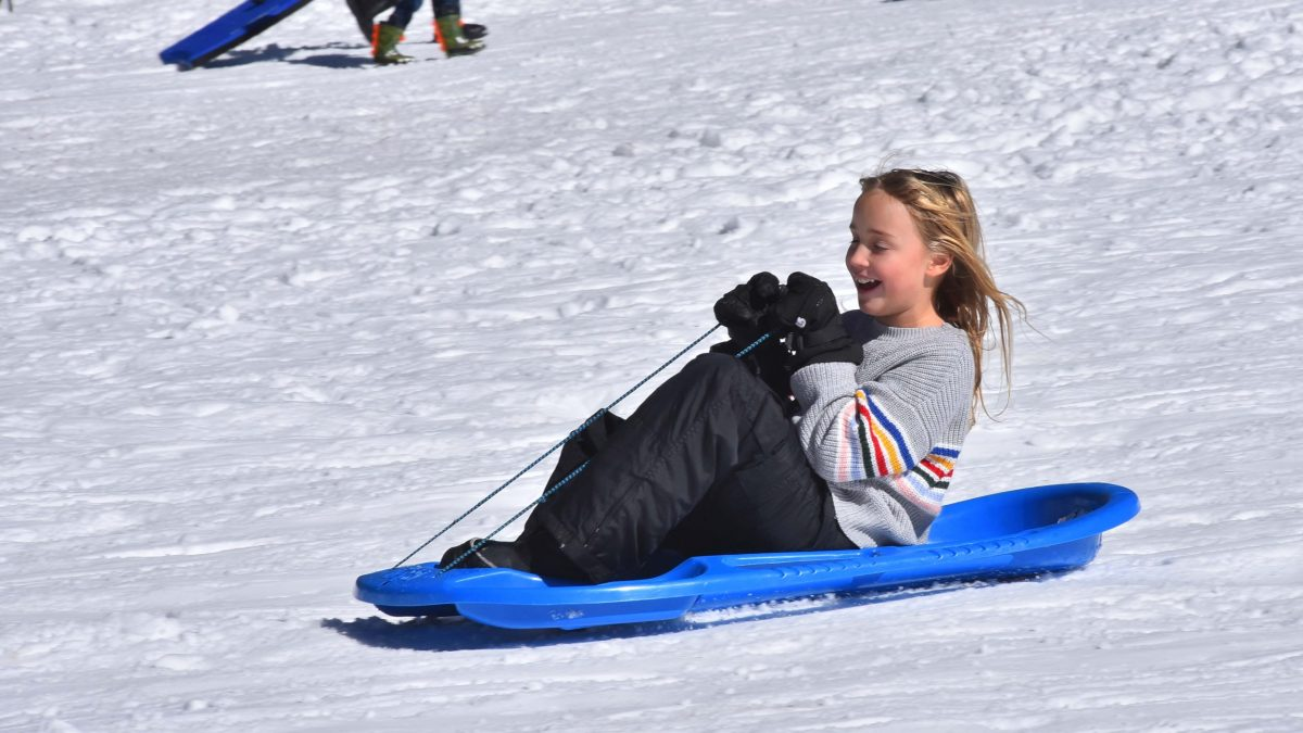 Children and adults took a midweek break between storms to enjoy the snow at Mt. Laguna.