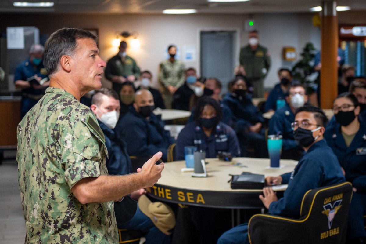 Adm. John Aquilino speaks to sailors