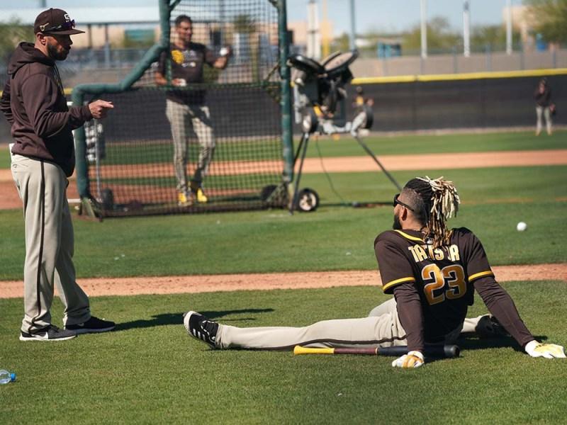 Padre manager Jayce Tingler (left) talks to infielder Fernando Tatis Jr. at spring training.