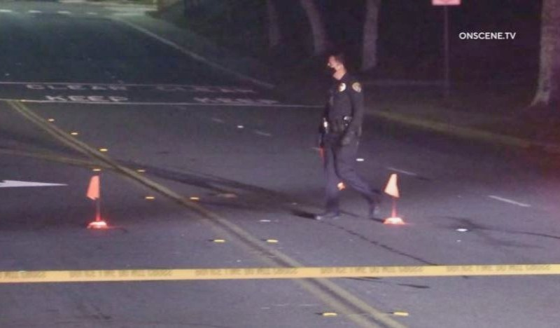 Officer examines street takeover intersection