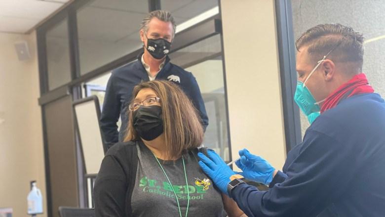 Gov. Gavin Newsom watches as teacher is vaccinated