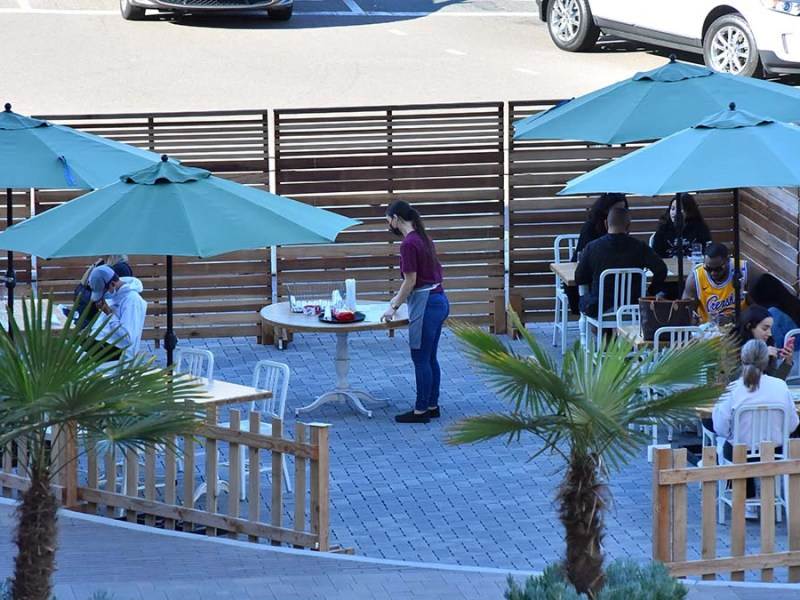 Tables are bussed at True Food outdoor dining area at Fashion Valley on Feb. 6, 2021.