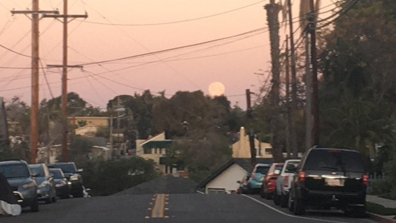 The full moon sets