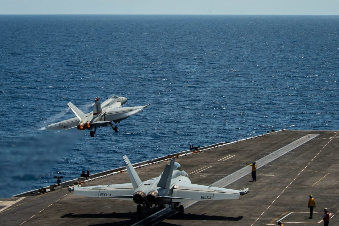 Jets launch from the USS Theodore Roosevelt