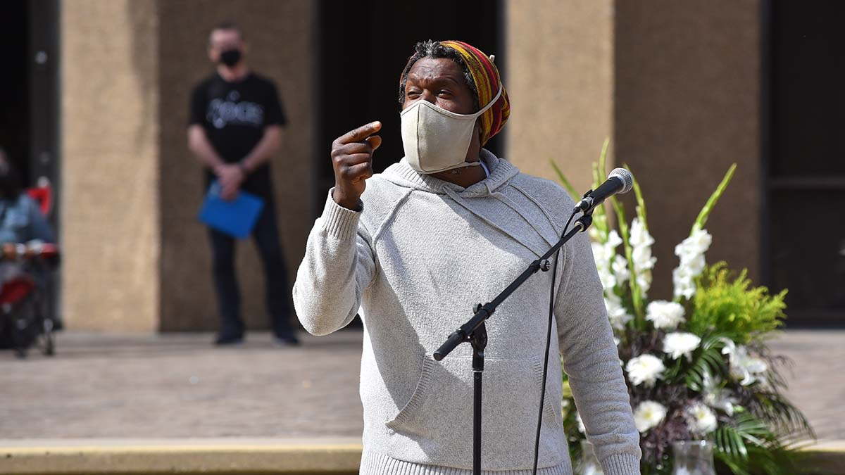 """""""Regal"""" spoke to the crowd about his friend Walter Jones, one of the three homeless men who were killed in a car crash."""